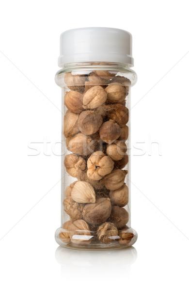 Black cardamom in a glass jar Stock photo © Givaga