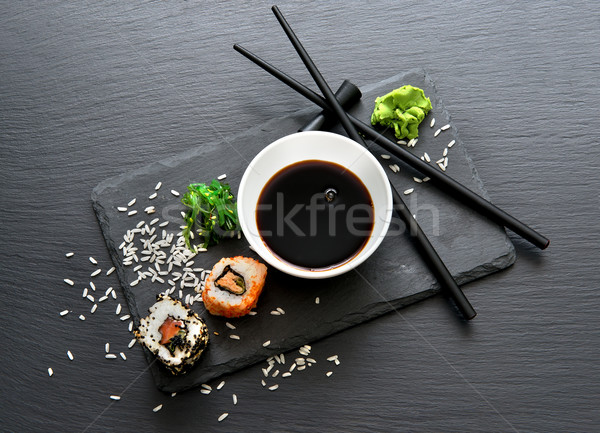 Rolls with sauce and chopsticks Stock photo © Givaga