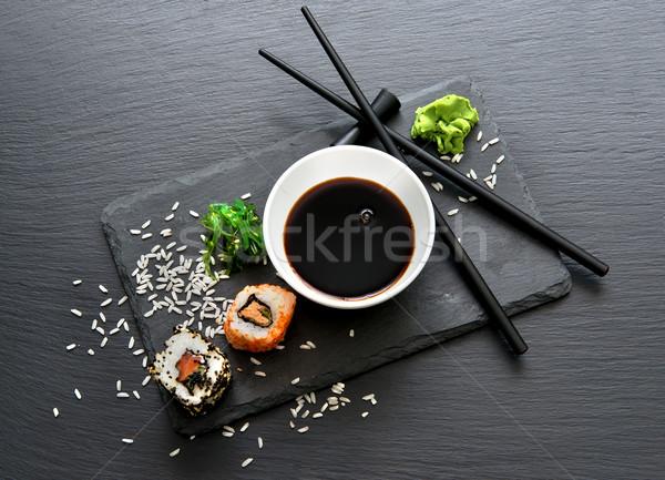 Tekercsek mártás evőpálcikák étel asztal piros Stock fotó © Givaga