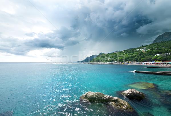 Storm clouds at sea Stock photo © Givaga