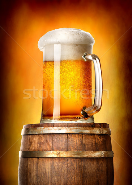 Beer with cask on yellow Stock photo © Givaga