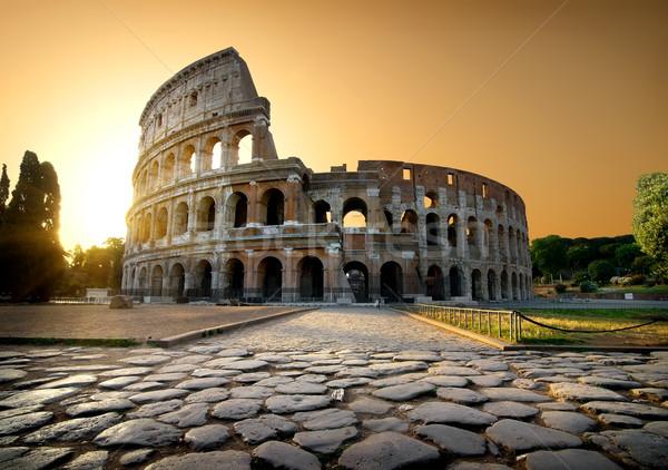 Colosseum citromsárga égbolt Róma Olaszország fű Stock fotó © Givaga