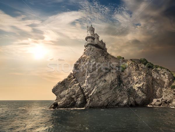 岩 海 曇った 空 雲 建物 ストックフォト © Givaga