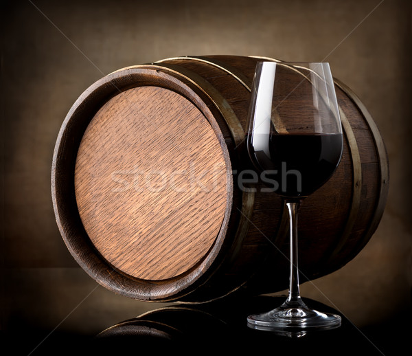 Red wine and a wooden barrel Stock photo © Givaga