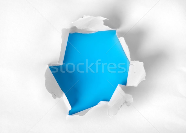 Paper torn with blue background Stock photo © Givaga