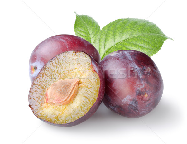 Three plums with leaves Stock photo © Givaga