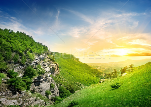 Bergen vallei hemel wolken landschap Stockfoto © Givaga