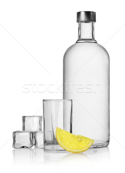 Bouteille vodka citron isolé blanche eau Photo stock © Givaga