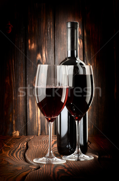 Stock photo: Two glasses of wine and wine bottle