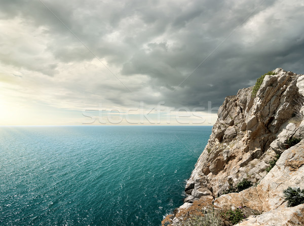 Gloomy clouds over the sea Stock photo © Givaga