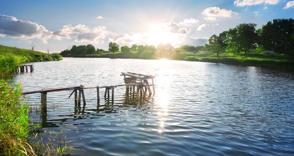 Podziale molo rzeki Świt niebo Zdjęcia stock © Givaga