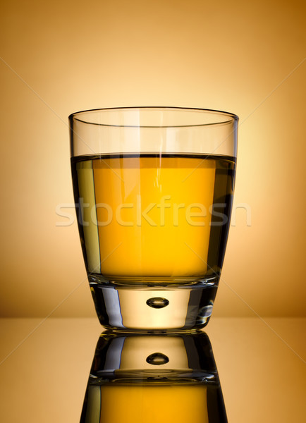 Whisky on a gold background Stock photo © Givaga