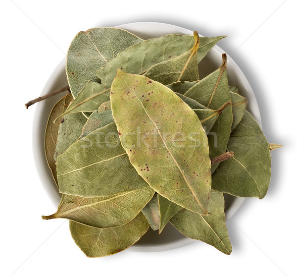 Bay leaves in plate isolated Stock photo © Givaga