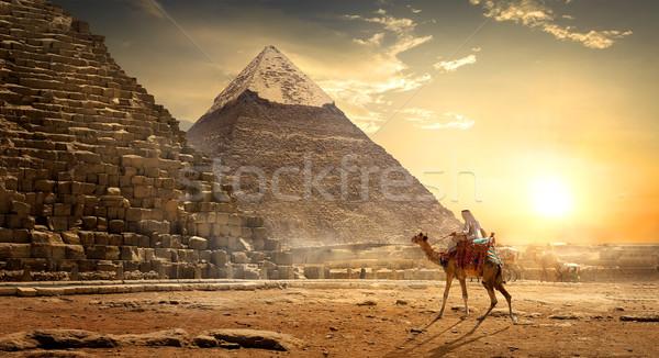 Stock photo: Nomad near pyramids