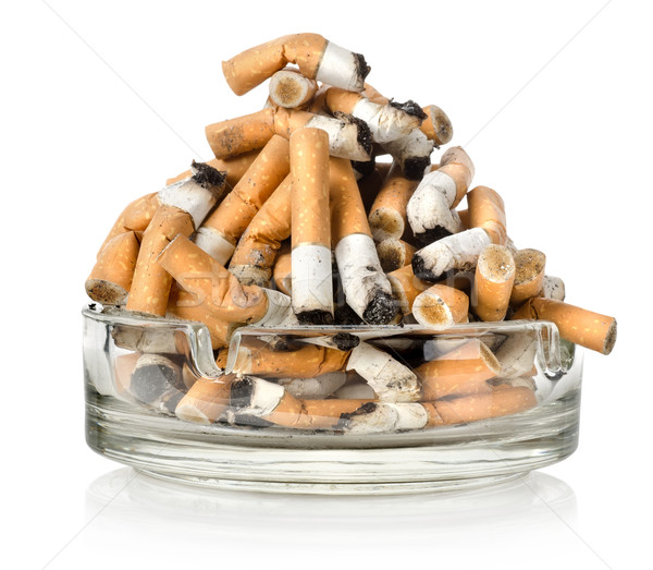 Stock photo: Ashtray and cigarettes