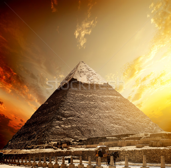 Fiery sunset and pyramid Stock photo © Givaga
