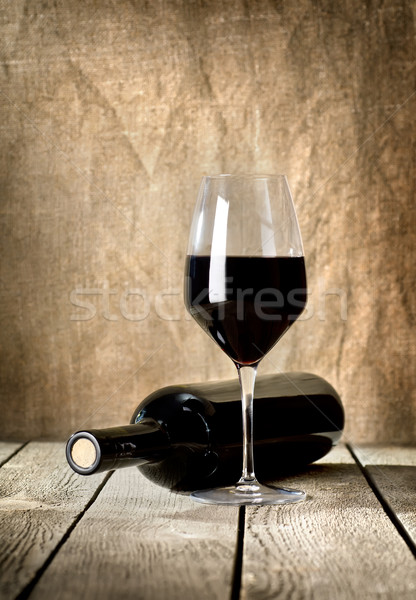 Black bottle of wine and wneglass Stock photo © Givaga