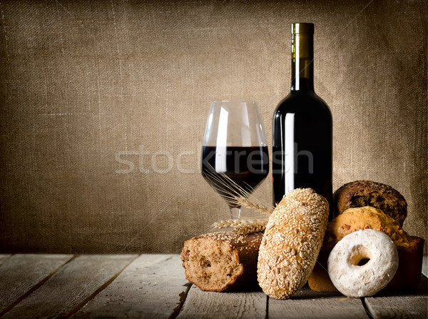 Red wine and assortment of bread Stock photo © Givaga