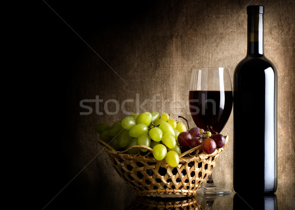 Wine on the old background Stock photo © Givaga