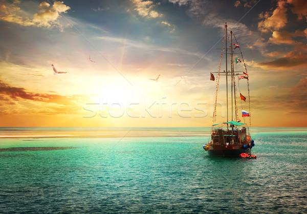 Sunset over yacht Stock photo © Givaga