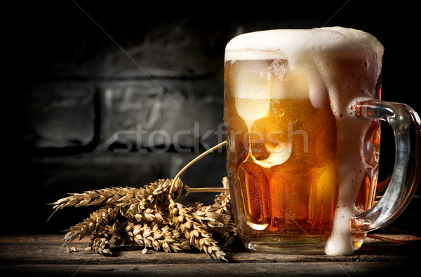 Beer near brick wall Stock photo © Givaga