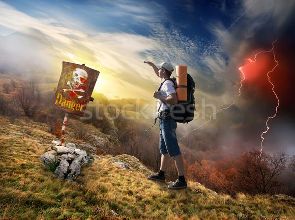 Tourist and thunder Stock photo © Givaga