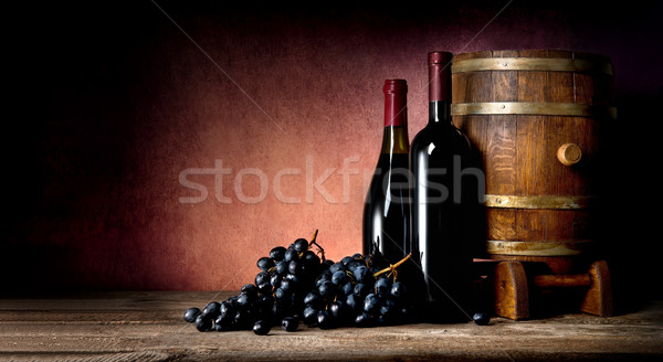 Bottles with cask and grape Stock photo © Givaga