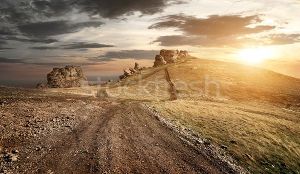Este hegyek vidéki út magas égbolt fű Stock fotó © Givaga