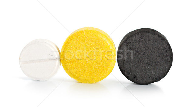 Pílulas isolado aspirina vitamina carvão branco Foto stock © Givaga