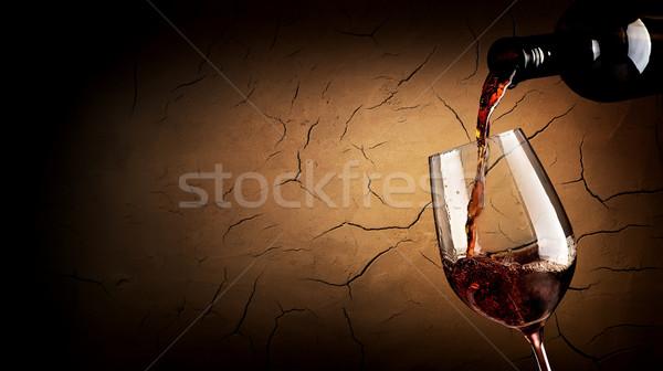 Pouring wine in cellar Stock photo © Givaga