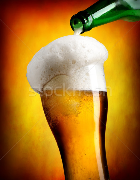 Beer pouring in tumbler Stock photo © Givaga