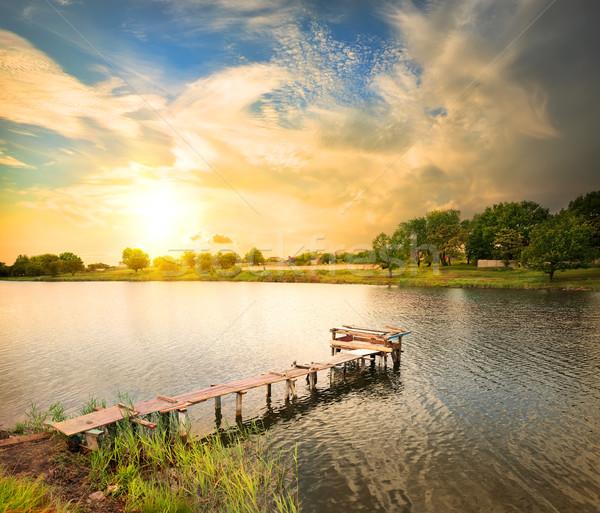 док пирс озеро вечер небе Сток-фото © Givaga