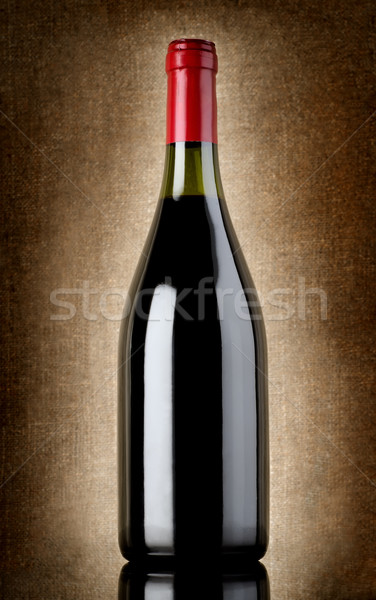 Bottle of wine on the old background Stock photo © Givaga