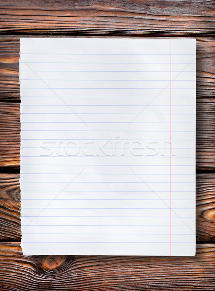 Lined paper on dark table Stock photo © Givaga