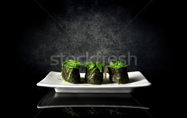 Pikantny sushi wodorost biały tablicy tle Zdjęcia stock © Givaga