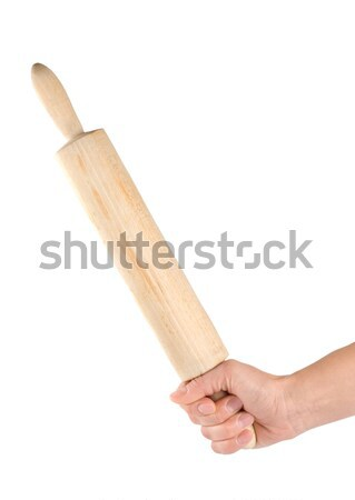 Rolling pin in a human hand Stock photo © Givaga