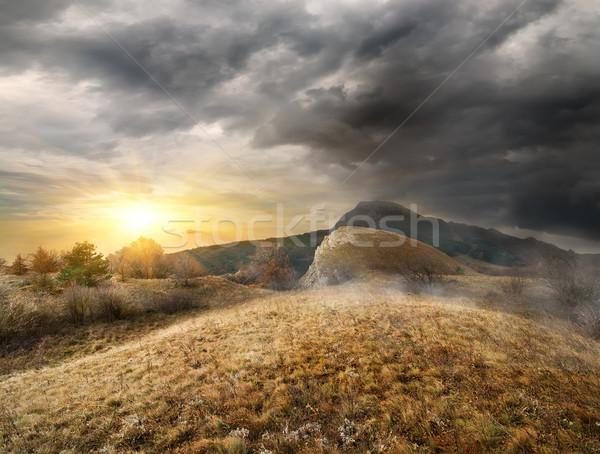 Belo nascer do sol montanhas outono madeira pôr do sol Foto stock © Givaga