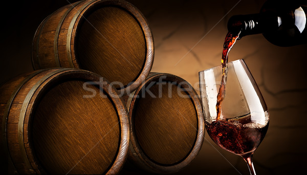 Pouring wine in cellar Stock photo © Givaga