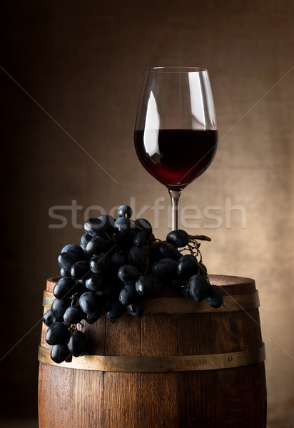 Wineglass with wooden barrel Stock photo © Givaga