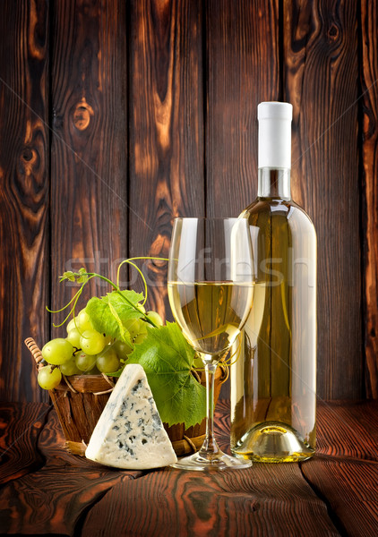 Stock photo: White wine with grapes and blue cheese