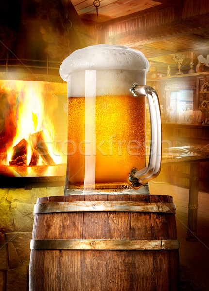 Beer and fireplace Stock photo © Givaga
