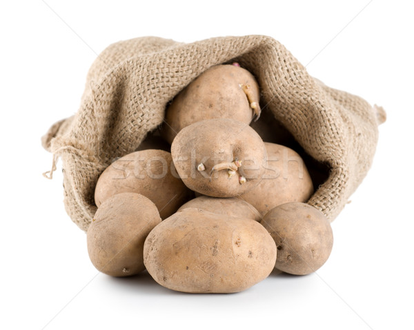 Raw potatoes in a hessian sack isolated Stock photo © Givaga
