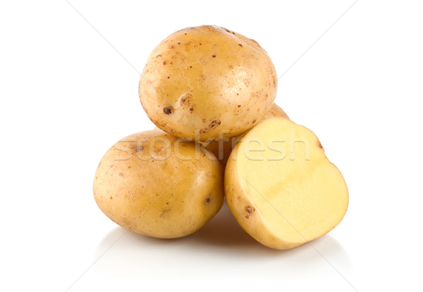 Four potatoes Stock photo © Givaga