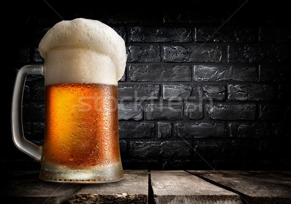 Beer and brick wall Stock photo © Givaga