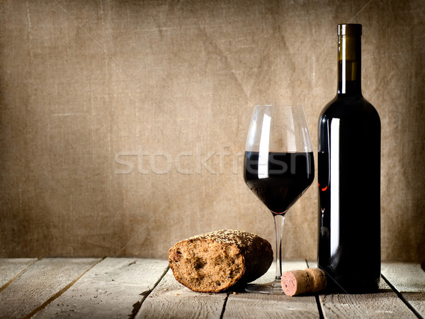 Wine and  bread on the table Stock photo © Givaga