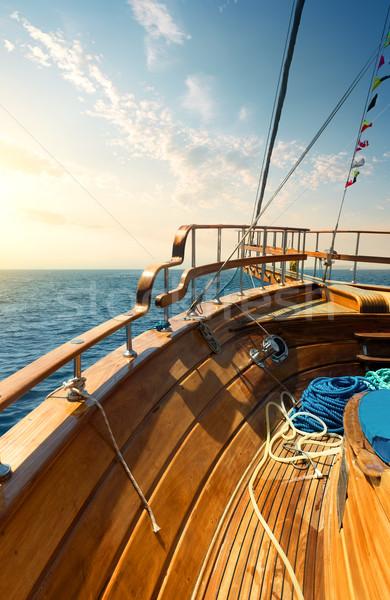 Sailboat at sunset Stock photo © Givaga