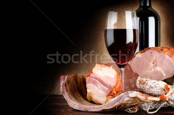 Wineglass and meat Stock photo © Givaga