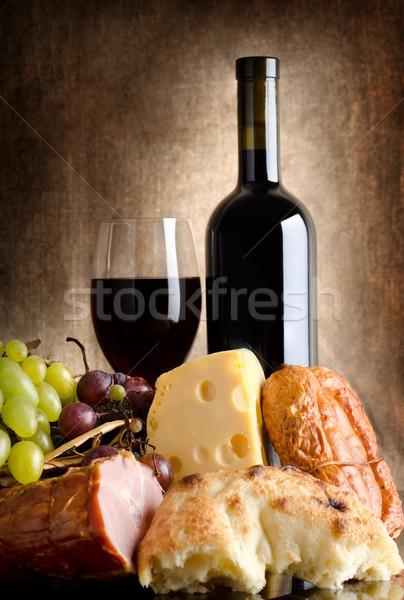 Abondance vin fromages raisins saucisse vieux Photo stock © Givaga