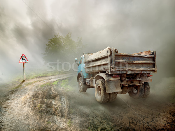 Dirty truck on a country road Stock photo © Givaga