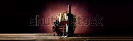 Wine with grape in basket Stock photo © Givaga